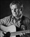 Musician Doc Watson poses backstage at McCabe's Guitar Shop in Santa Monica, California, in this 1986 publicity photo released to Reuters on May 25, 2012. Grammy-winning folk musician Watson died May 29, 2012 at the age of 89 after undergoing colon surgery last week at a North Carolina hospital, according to his management team. REUTERS/Peter D. Figen/Handout