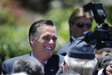 Mitt Romney, U.S. Republican presidential candidate and former Massachusetts governor, shakes hands with supporters during a memorial day ceremony held at the Veterans Museum & Memorial Center in San Diego, California May 28, 2012. REUTERS/Denis Poroy