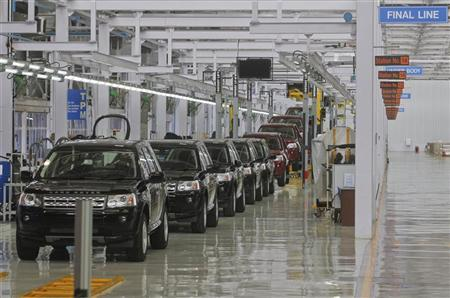 Jaguar Land Rover Freelander 2 vehicles are displayed on the production line for the media at their newly-inaugurated production plant in Pune, 190km (118 miles) south of Mumbai, May 27, 2011. REUTERS/Danish Siddiqui