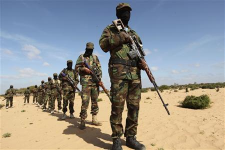 Members of Somalia's Al Shabaab militant group parade during a demonstration to announce their integration with al Qaeda, in Elasha, south of the capital Mogadishu February 13, 2012. Picture taken February 13, 2012. REUTERS/Feisal Omar/Files