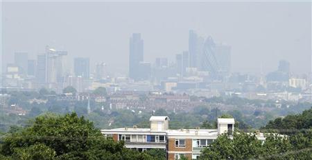 Buildings in the financial district are obscured in a haze, as seen from Crystal Palace in south London June 26, 2010. REUTERS/Paul Hackett