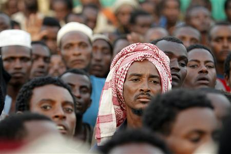 Ethiopian migrants gather outside a transit center where they wait to be repatriated, in the western Yemeni town of Haradh, on the border with Saudi Arabia March 28, 2012. Plagued by sandstorms, drought, gun runners and drug smugglers, the 1,800-km (1,100-mile) strip of land along the Yemeni-Saudi border has long been a desolate, dangerous place. But crumbling government control and a surge of migrants, driven out of the Horn of Africa by poverty and persecution, have turned it into a kind of hell where criminal gangs roam freely, trading migrants like commodities. Picture taken on March 28, 2012. REUTERS/Khaled Abdullah