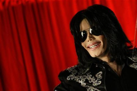 U.S. pop star Michael Jackson gestures during a news conference at the O2 Arena in London March 5, 2009. Jackson said he will hold a series of final concerts in Britain later in the year. REUTERS/Stefan Wermuth