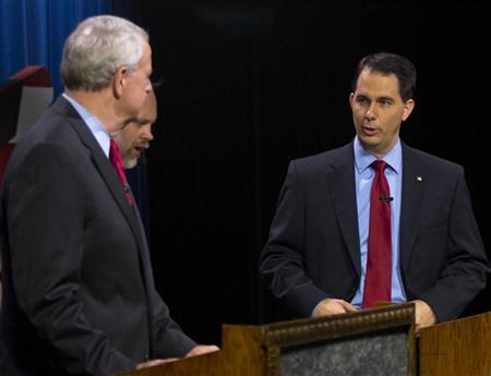 Republican Wisconsin Gov. Scott Walker, who is facing a recall election, faces off against democratic challenger and Milwaukee Mayor Tom Barrett (L) before the start of the debate in Milwaukee, Wisconsin May 25, 2012. REUTERS/Darren Hauck