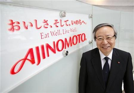Japanese spice maker Ajinomoto Co President and CEO Masatoshi Ito poses next to the company logo during a photo opportunity at the company headquarters in Tokyo May 30, 2012. REUTERS/Yuriko Nakao