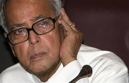 Finance Minister Pranab Mukherjee listens to a question during a news conference in New Delhi May 27, 2009. REUTERS/B Mathur/Files