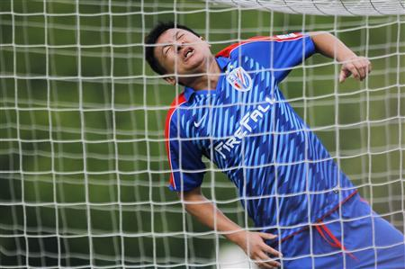 Zhu Jun, owner of Shanghai Shenhua football club, reacts after missing a goal during a friendly match against Argentina CN Sports during the 2012 Shanghai International Football Tournament in Shanghai May 31, 2012. Former Argentina manager Sergio Batista has been appointed head coach of Shanghai Shenhua to replace the sacked Jean Tigana, the big spending Chinese club said in a statement on Wednesday. REUTERS/Carlos Barria