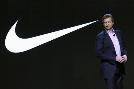 NIKE, Inc. President & CEO Mark Parker appears at an event to unveil the new NIKE+ FuelBand, an innovative wristband that tracks and measures everyday movement for, what Nike says, motivates and inspires people to be more active, in New York, January 19, 2012. REUTERS/Mike Segar