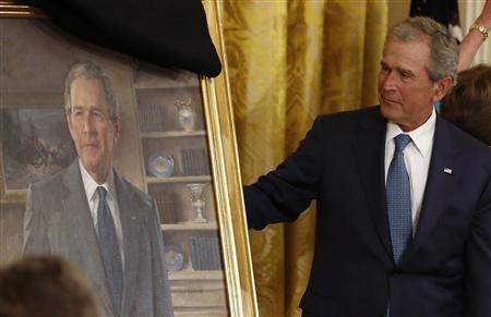 Former U.S. President George W. Bush unveils his official White House portrait during a ceremony in the East Room of the White House in Washington May 31, 2012. REUTERS/Jason Reed