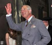 Britain's Prince Charles waves to the crowd of people gathered in the rotunda of the Saskatchewan Legislative Assembly in Regina, Saskatchewan, May 23, 2012. REUTERS/Fred Greenslade