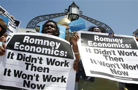 Supporters of President Barack Obama hold signs outside the Massachusetts State House before the start of a news conference in Boston, Massachusetts May 31, 2012. Obama's campaign attacked Republican rival Mitt Romney on Thursday for failing to create jobs as Massachusetts governor, calling it more evidence of a flawed economic approach that would be disastrous in the White House. REUTERS/Jessica Rinaldi