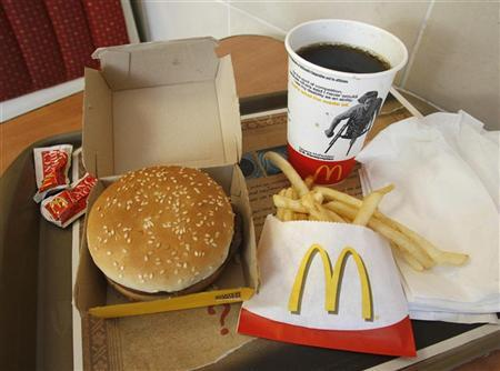 A meal consisting of a Quarter Pounder hamburger, french fries and soft-drink is pictured at a McDonald's restaurant in Los Angeles, California July 23, 2008. REUTERS/Fred Prouser