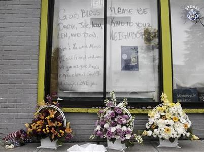 Flowers sit outside the Cafe Racer after Wednesday's deadly shooting incident in Seattle, Washington, May 31, 2012. A gunman killed four people at the popular Seattle cafe on Wednesday then fled to a downtown parking lot where he killed a fifth person and stole her car before shooting himself in the head as police closed in, authorities said. REUTERS/Robert Sorbo