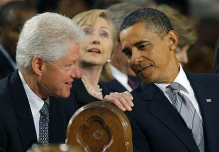 U.S. President Barack Obama (R) talks with former U.S. President Bill Clinton (L) and his wife, Secretary of State, Hillary Clinton (C) during the funeral services for U.S. Senator Edward Kennedy at the Basilica of Our Lady of Perpetual Help in Boston, Massachusetts August 29, 2009. REUTERS/Brian Snyder