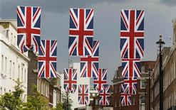 Union Jack flags hang over Elizabeth Street in London May 30, 2012. REUTERS/Suzanne Plunkett