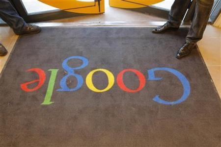 A Google carpet is seen at the entrance of the headquarters of Google France in Paris December 6, 2011. REUTERS/Jacques Brinon/Pool/Files