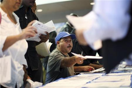 Job seekers fill out applications during the 11th annual Skid Row Career Fair at the Los Angeles Mission in Los Angeles, California, May 31, 2012. REUTERS/David McNew