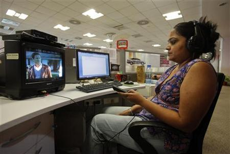 An in-house censor reviews a movie which will eventually air on the Sony Pix channel at the channel's office in Mumbai May 8, 2012. REUTERS/Vivek Prakash