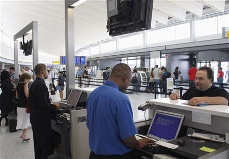People are seen in new JetBlue Airways Terminal 5 at John F. Kennedy International Airport during a terminal test in New York August 23, 2008. REUTERS/Joshua Lott