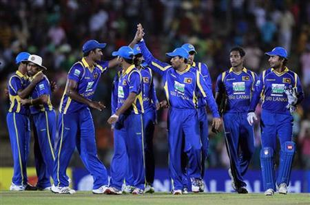 The Sri Lankan cricket team celebrates after winning their first Twenty20 (T20) cricket match against Pakistan in Hambantota, about 240km (149 miles) south of Colombo June 1, 2012. REUTERS/Dinuka Liyanawatte