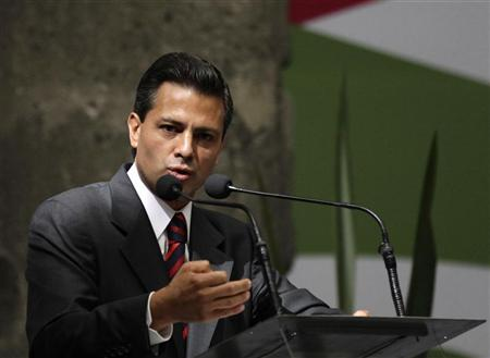 Enrique Pena Nieto, presidential candidate from the opposition Institutional Revolutionary Party (PRI), gives a speech during the First Citizen Summit in Mexico City May 22, 2012. REUTERS/Henry Romero