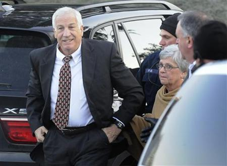 Former Penn State assistant football coach Jerry Sandusky (L) gets out of a car with his wife Dottie (2nd R) as he arrives for a preliminary hearing to determine if there is enough evidence to hold him for trial on charges of sexually abusing boys, at the Centre County Courthouse in Bellefonte, Pennsylvania, December 13, 2011. REUTERS/Jonathan Ernst