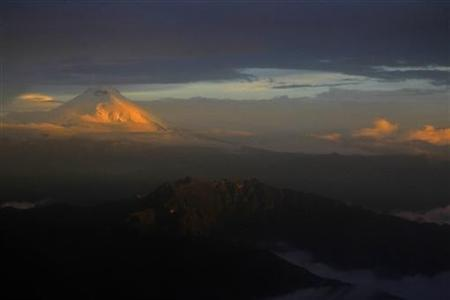 The Cotopaxi mountain, the highest active volcano in Ecuador, is seen from a plane during a flight to Quito April 24, 2011. The Cotopaxi, a stratovolcano in the Andes Mountains, is one of the highest active volcanoes in the world, at 5,897 metres (19,347 feet). REUTERS/Guillermo Granja