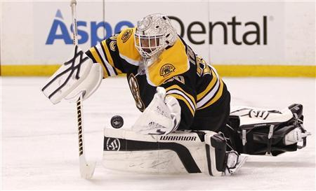 Boston Bruins goalie Tim Thomas makes a save against the Washington Capitals during the third period in Game 7 of their NHL Eastern Conference quarter-final hockey playoff series in Boston, Massachusetts April 25, 2012