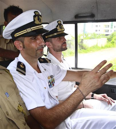 Italian sailors Massimiliano Latorre (L) and Salvatore Girone sit in a police vehicle after they appeared in court in the southern Indian city of Kochi June 2, 2012. REUTERS/Sivaram V