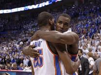 Oklahoma City Thunder power forward Serge Ibaka (R) hugs teammate Kevin Durant (35) after defeating the San Antonio Spurs following Game 4 of the NBA Western Conference basketball finals in Oklahoma City, Oklahoma June 2, 2012. REUTERS/Jim Young
