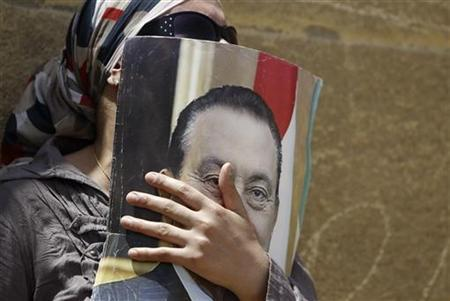 A supporter of deposed president Hosni Mubarak reacts after a court sentenced him to life in prison, outside the police academy where the court is located in Cairo June 2, 2012. REUTERS/Amr Abdallah Dalsh
