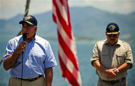 U.S. Defense Secretary Leon Panetta (L) speaks to the crew next to United States Navy ship (USNS) Richard E. Byrd Master Captain John Sargent as he visits the ship in Cam Ranh Bay June 3, 2012. REUTERS/Jim Watson/Pool