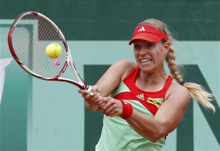 Angelique Kerber of Germany returns the ball to Petra Martic of Croatia during the French Open tennis tournament at the Roland Garros stadium in Paris June 3, 2012. REUTERS/Regis Duvignau