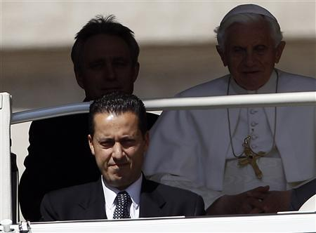 The Pope's butler, Paolo Gabriele (bottom L), arrives with Pope Benedict XVI (R) at St. Peter's Square in the Vatican in this May 23, 2012 file photo. REUTERS/Alessandro Bianchi/Files