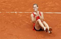Dominika Cibulkova of Slovakia reacts after winning her match against Victoria Azarenka of Belarus during the French Open tennis tournament at the Roland Garros stadium in Paris June 3, 2012. REUTERS/Regis Duvignau