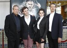 """Director of the movie Rupert Sanders (R) poses with cast members Kristen Stewart and Sam Claflin (2nd L), and producer Joe Roth at an industry screening of """"Snow White and the Huntsman"""" at the Mann Village theatre in Westwood, California May 29, 2012. The movie opens in the U.S. on June 1. REUTERS/Mario Anzuoni"""