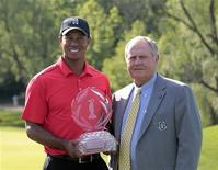 Tiger Woods (L) of the U.S. holds the winners trophy with Jack Nicklaus (R) after winning the Memorial Golf Tournament at Muirfield Village Golf Club in Dublin, Ohio June 3, 2012. REUTERS/John Sommers II