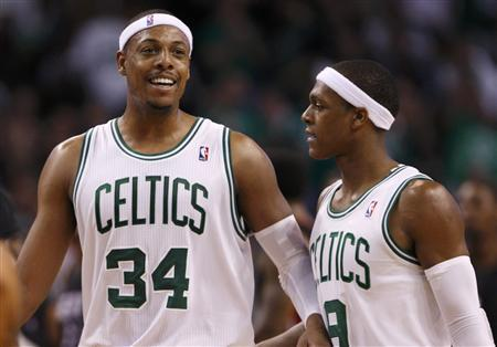 Boston Celtics' Paul Pierce (34) celebrates with Rajon Rondo during Game 4 of their Eastern Conference Finals NBA basketball playoffs against the Miami Heat in Boston, Massachusetts June 3, 2012. REUTERS/Jessica Rinaldi