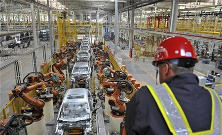 An employee looks at an assembly line at a Ford manufacturing plant in Chongqing municipality April 20, 2012. REUTERS/Stringer