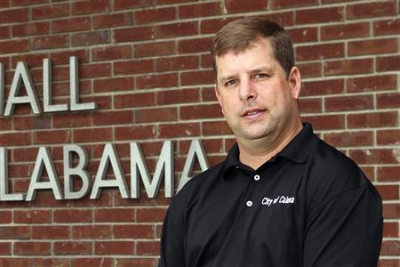 Jon Graham, the mayor of Calera, Alabama, poses for a photo outside the City Hall May 15, 2012. Graham says the city was not trying to reduce black voter strength when it redrew District 2 in 2008. To the contrary, he said, thanks to increased integration, it would have been hard to draw a majority-black district without creating wildly gerrymandered lines. Picture taken May 15, 2012. REUTERS/Marvin Gentry