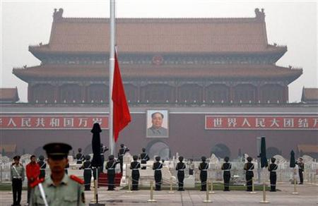 Paramilitary policemen stand guard as the Chinese national flag is raised on Beijing's Tiananmen Square June 4, 2012. Monday marks the 23rd anniversary of the military crackdown on the square of a student pro-democracy movement. REUTERS/David Gray