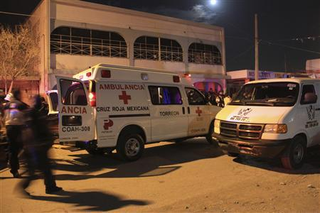 Members of the Red Cross stand beside their ambulances outside a drug rehabilitation clinic which was attacked by gunmen in the outskirts of Torreon June 3, 2012 in this handout picture released by the Attorney General of Torreon. REUTERS/PGJ-Attorney General of Torreon/Handout
