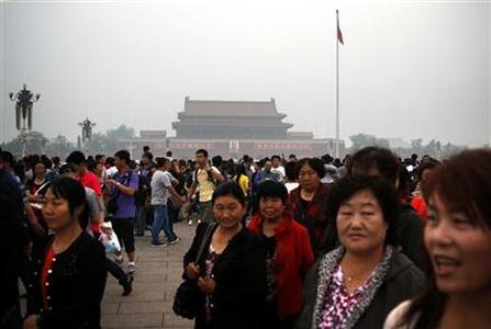 Members of a crowd walk on Tiananmen Square after the raising of the Chinese national flag in Beijing June 4, 2012. Monday marks the 23rd anniversary of the military crackdown on the square of a student pro-democracy movement. REUTERS/David Gray