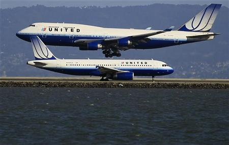 United Airlines planes take off and land at San Francisco airport, California January 21, 2012. REUTERS/Lucy Nicholson