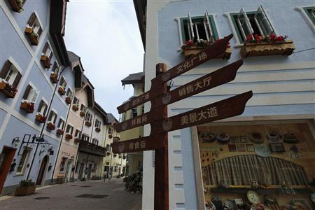 A Chinese road sign is seen at the replica of Austria's UNESCO heritage site, Hallstatt village, in China's southern city of Huizhou in Guangdong province June 1, 2012. REUTERS/Tyrone Siu