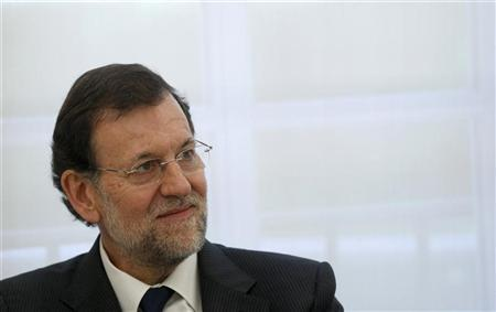 Spanish Prime Minister Mariano Rajoy smiles during a meeting at Moncloa palace in Madrid June 4, 2012. REUTERS/Andrea Comas