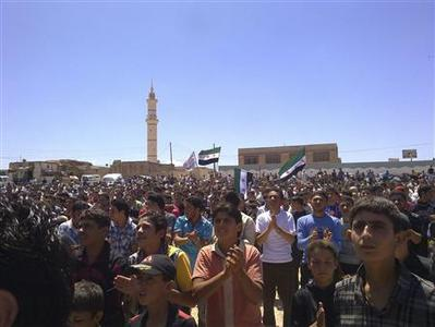 Demonstrators protest against Syria's President Bashar al-Assad in Habeet, near Idlib, June 1, 2012. REUTERS/Shaam News Network/Handout