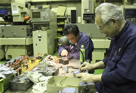 Factory workers polish dies at a factory in Osaka, western Japan, May 23, 2012. REUTERS/Yoko Kubota