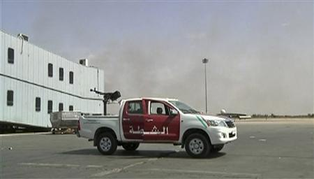 A vehicle mounted with an anti-aircraft gun is seen on the tarmac at Tripoli's international airport in this still image taken from video June 4, 2012. REUTERS/Reuters TV