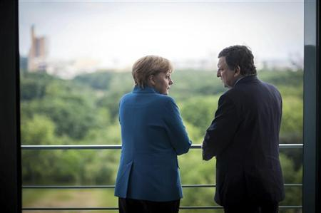German Chancellor Angela Merkel speaks with European Commission President Jose Manuel Barroso at the start of their meeting at the Chancellery in Berlin, June 4, 2012. REUTERS/Bundesregierung/Guido Bergmann/Pool